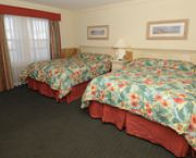 Beds Adjacent To A Fully-equipped Kitchenette And Seating For Four. - Hatteras Marlin Motel