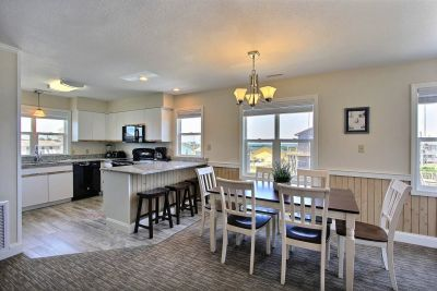 Dining area and kitchen at a Lighthouse View Oceanfront Lodging rental